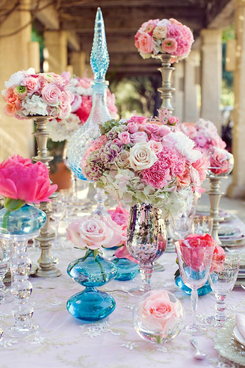 Image courtesy of: http://wedwebtalks.com/2014/10/creative-ideas-on-wedding-centerpieces-with-champagne-glasses/colorful-wedding-centerpieces-with-champagne-glasses/
